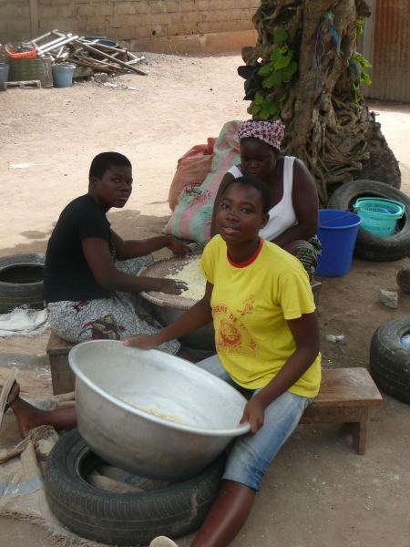 Women as  usual not being lazy, here making attieke (a cassava based food similar to cous cous) in Cote d'Ivoire
