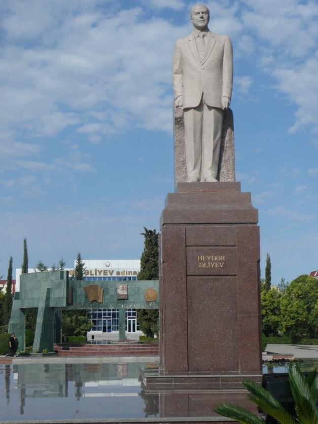 Heydar Aliyev statue in Heydar Aliyev park on Heydar Aliyev St with Heydar Aliyev building behind (yes really)