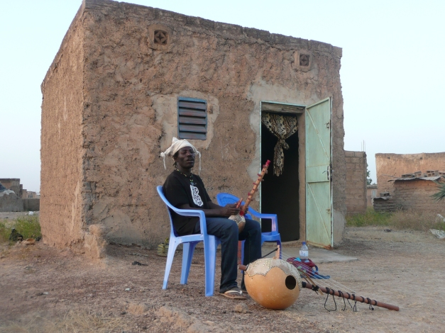 Mamadou outside his home
