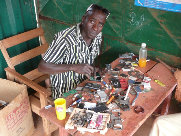 The name Barry may have dropped off the popular names charts in the UK in 1972 but remains popular here. Showing great African resoucefulness Barry scavanges parts from a pile of old mobiles to repair others