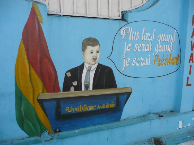 """When I grow up I will be President"". Motivating mural on school wall in Conakry, Guinea."