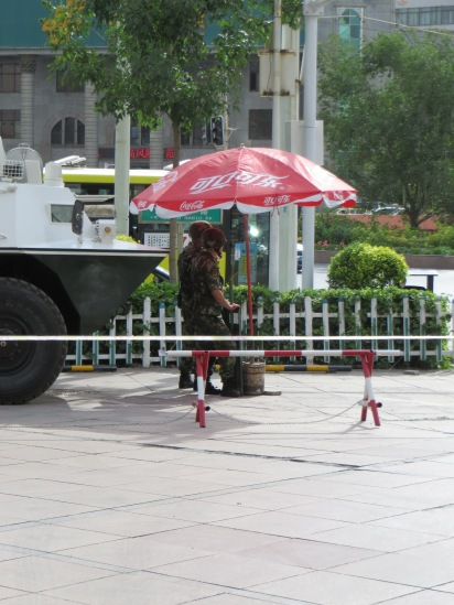 Soldiers hard at work under a parasol