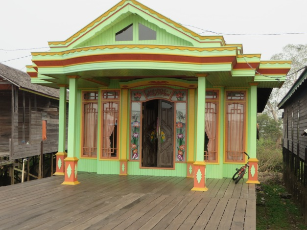 Even the humble wooden house is a candidate for a splurge of colour
