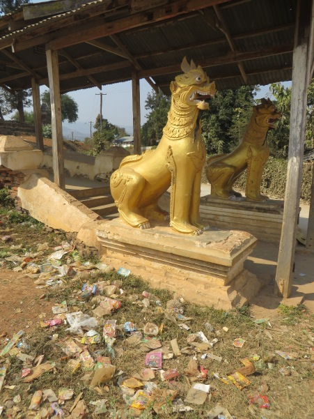 Offerings of holy garbage at a temple entrance