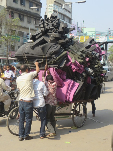And the winner for most crap piled onto a rickshaw is.......
