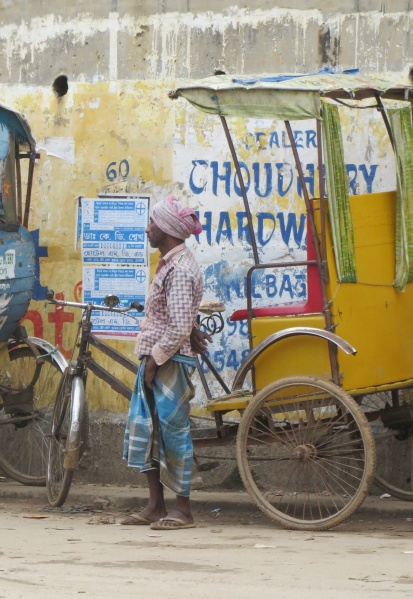 Deespite the often rugged terrain the rickshaw still remians a vital form of transportl