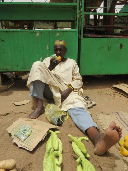 Sudanese market seller clearly unconcerned by the evils of colonialism