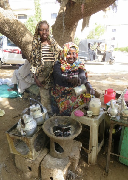 Zeinab and her daughter Alaya providing tea with a smile in Wad madani