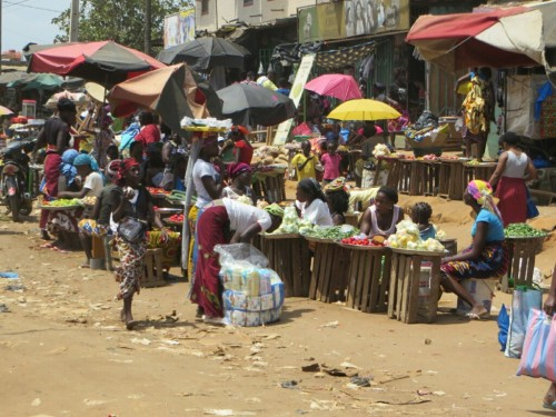One of the local markets. Note how much of it is made up of women with just a single tray of goods